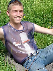 Naughty outdoor enthusiast Hubert playing with his cock on a green meadow